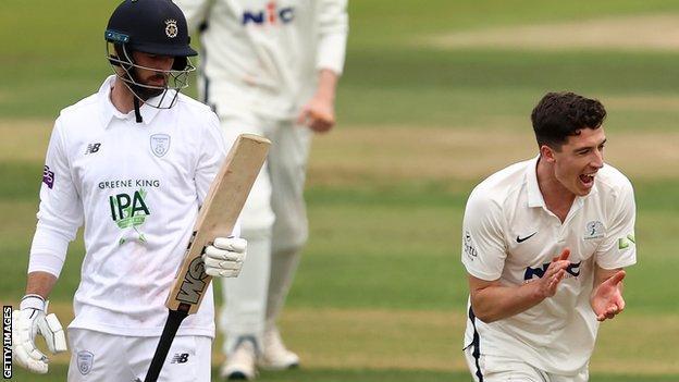 Matt Fisher celebrates the wicket of James Vince