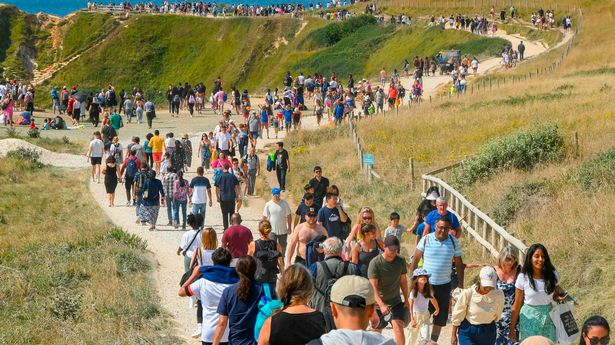 The South West Coast Path is busy as holidaymakers and visitors flock to Durdle Door