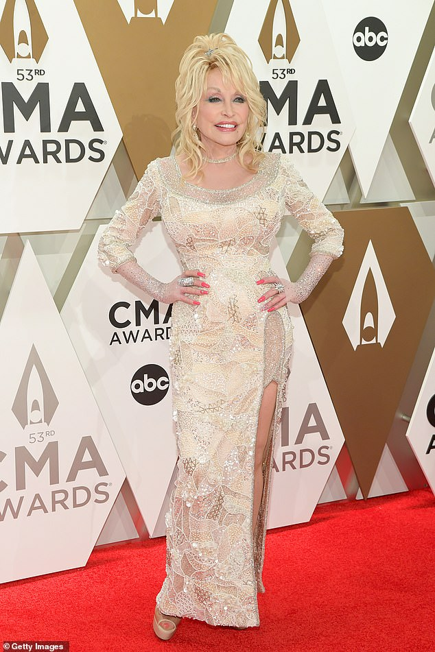 Queen: Dolly Parton built an estimated $350million fortune through her extensive catalog of publishing rights and her own theme park in Tennessee which she cofounded 35 years ago; seen in 2019