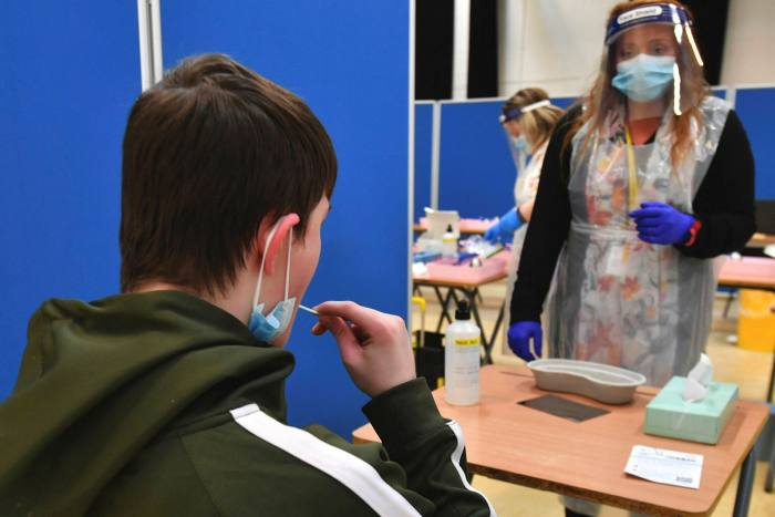 A pupil takes a Covid test at a school in Manchester
