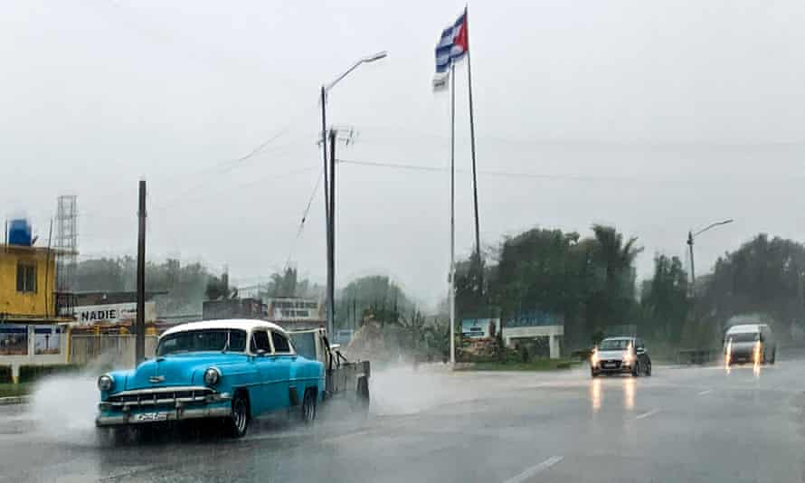 People drive under the rain in Havana on Friday as Hurricane Ida passes through Cuba.