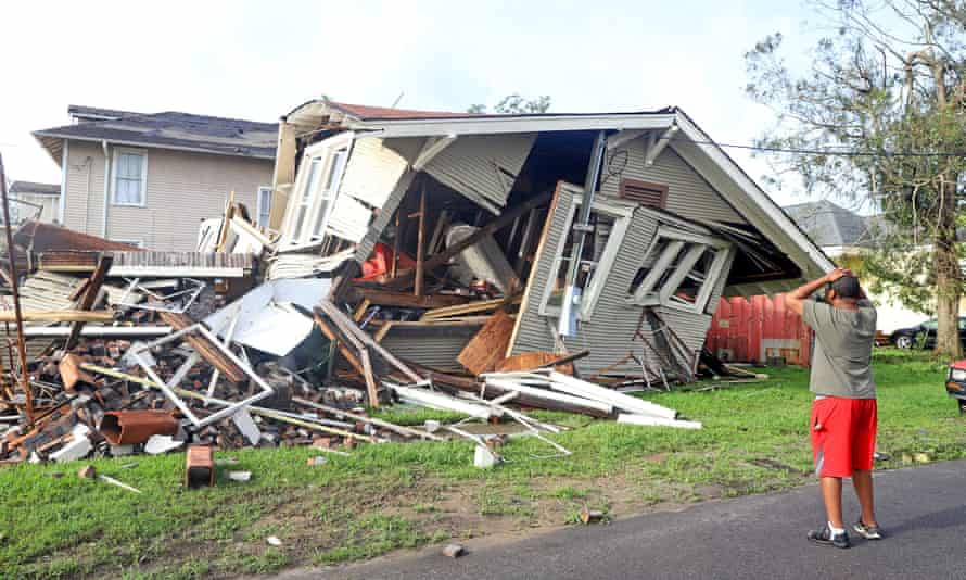 A man looks at the house that collapsed with him inside during Hurricane Ida in New Orleans.