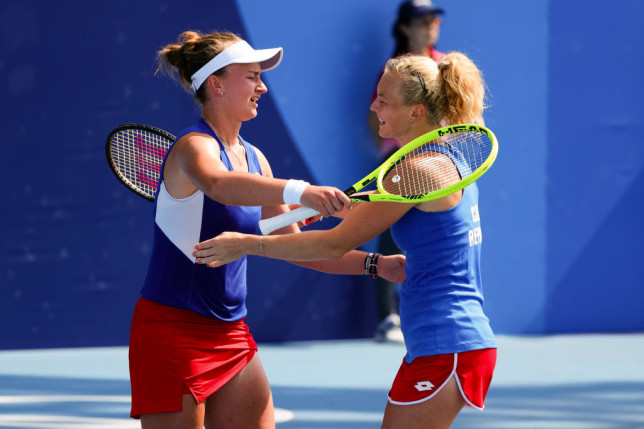 Katerina Siniakova and Barbora Krejcikova embrace after winning the match during the Women's Doubles Tennis Quarter Final match between Ash Barty and Storm Sanders of Australia and Barbora Krejcikova and Katerina Siniakova of Czech Republic on Day 5 of the Tokyo 2020 Olympic Games at Ariake Tennis Park on July 28, 2021 in Tokyo, Japan.