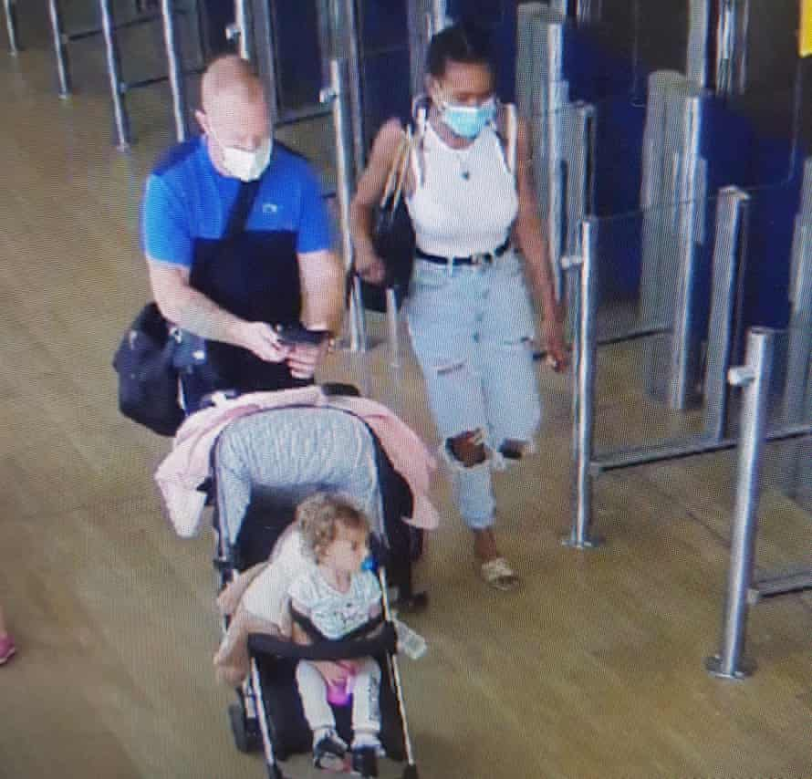 A CCTV images shows Lee Rogers (left) and Kelly Gibson with Gracie-May Rogers at Glasgow airport.