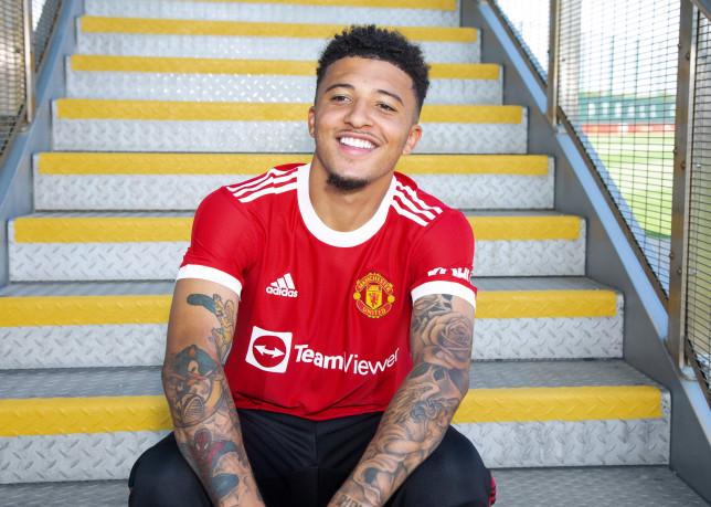 Jadon Sancho poses in Manchester United kit after transfer
