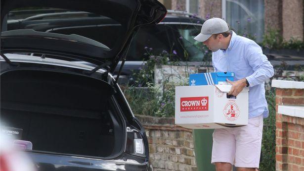 Matt Hancock loading up his car with boxes
