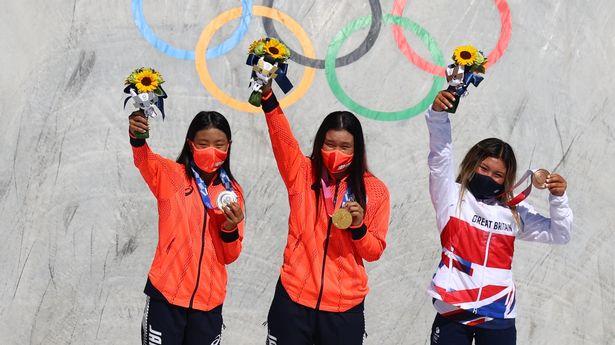 Sky Brown celebrates her bronze medal