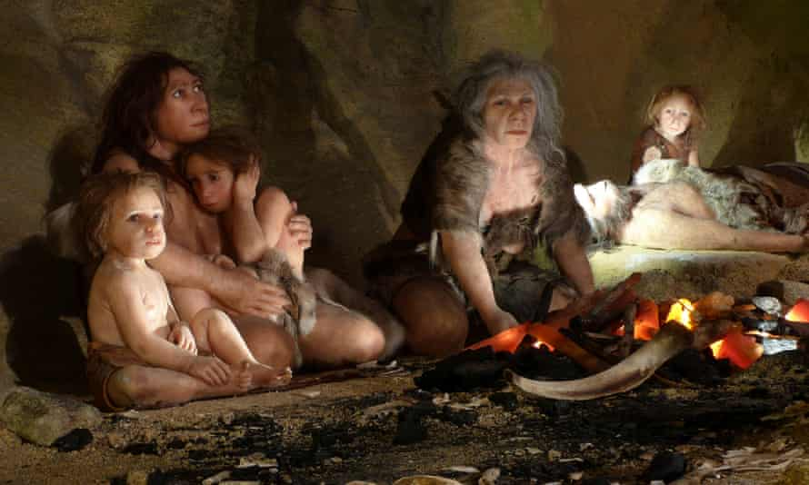A depiction of a neanderthal family in a cave.
