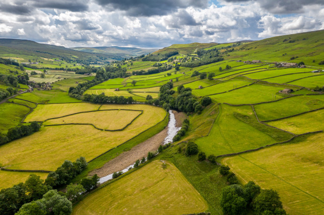 The River Swale snakes through the countryside of Swaledale, Yorkshire, UK.