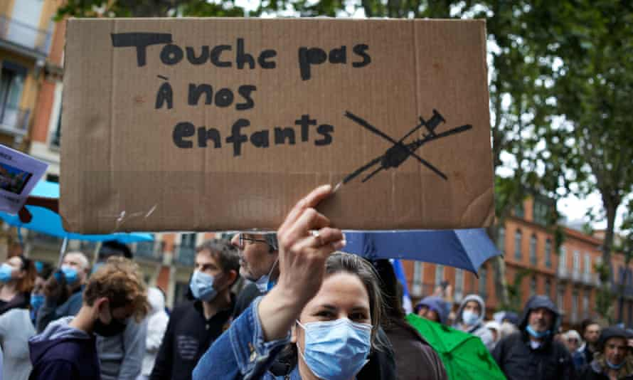 A woman holds a cardboard reading 'Don't touch my children' at a protest in Toulouse last month.