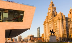 A view of Liverpool's Pier Head waterfront area, with the ferry terminal, the Liver building and a statue of Edward VII