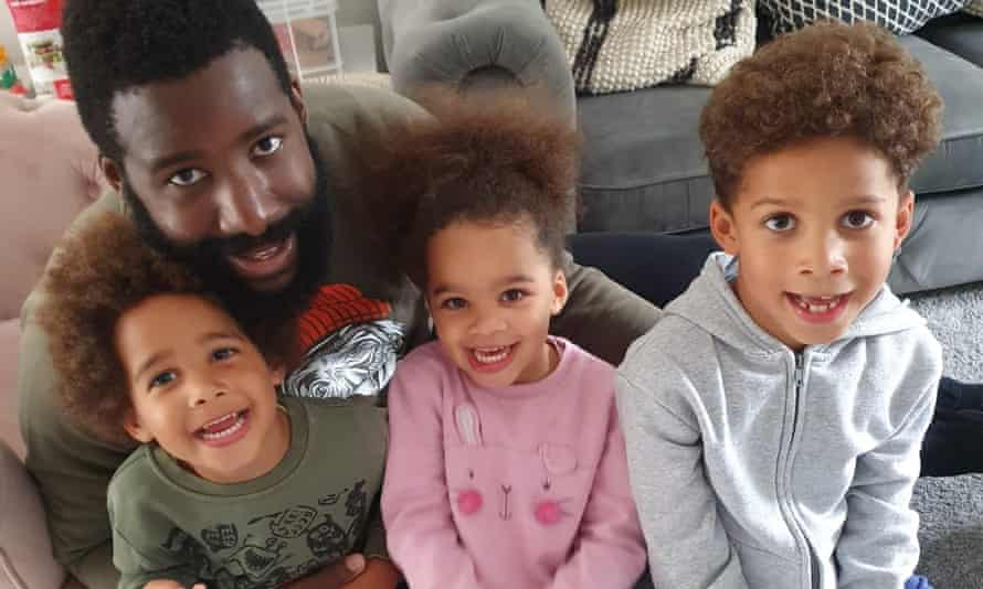 Travis Newton with his seven-year-old son and three-year-old twins