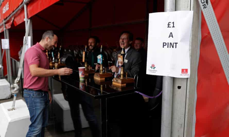 Every cloud … a spectator buys a reduced pint at Old Trafford after the fifth Test was cancelled on Friday morning.