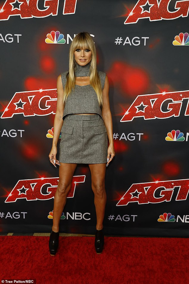 Red carpet ready:She completed her look with a pair of black platform heels, while tagging hair stylist Lorenzo Martin, stylists and costume designers Rob Zangardi and Mariel Haenn and jeweler Jennifer Fisher