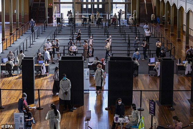 Pictured: People queue up inside the Royal Exhibition Building COVID19 Vaccination Hub in Melbourne, Australia, 02 September 2021. Most of Victoria's tough coronavirus restrictions will remain in place until 70 percent of eligible people have received at least one vaccine dose