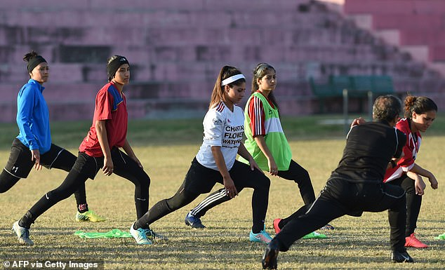The Taliban will also ban Afghan women from playing sport because 'their face and body will not be covered'. Pictured the Afghan women's football team in November, 2014