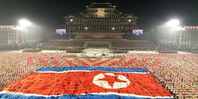 """In this photo provided by the North Korean government, a huge North Korean flag is displayed during a celebration of the nation's 73rd anniversary at Kim Il Sung Square in Pyongyang, North Korea, early Thursday, Sept. 9, 2021. Independent journalists were not given access to cover the event depicted in this image distributed by the North Korean government. The content of this image is as provided and cannot be independently verified. Korean language watermark on image as provided by source reads: """"KCNA"""" which is the abbreviation for Korean Central News Agency. (Korean Central News Agency/Korea News Service via AP)"""