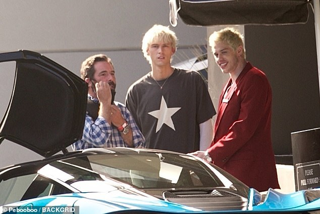 Ugly:Production sources for TMZ claimed the attendant had wandered into the middle of the LA shoot as he did not receive a memo about the filming when he began yelling at a crewmember to get out of the lot, as MGK is seen with Pete Davidson on set