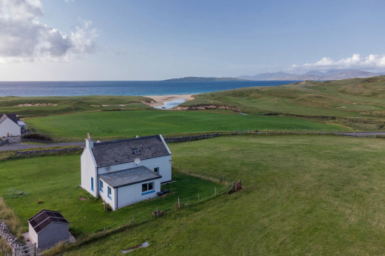 An idyllic cottage on the Isle of Harris has gone on the market with sea views from every room in the house.