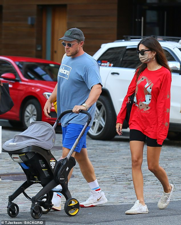 Taking charge: Bear-McClard, 34, took the lead and pushed their son's stroller most of the walk