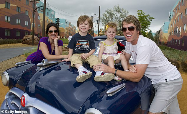 Family man: Rooney and Fallon have three children: son Jagger and daughters Raquel and Devon; the proud parents are seen with two of the kids in June 2012