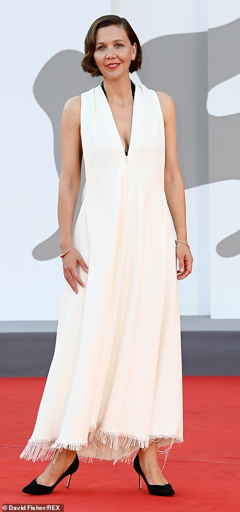 What a beauty:Maggie Gyllenhaal wowed in white as she posed on the red carpet on Saturday
