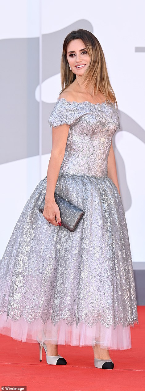 Wow: Penelope oozed grace and glamour as she glided across the carpet in her jaw-dropping gown which featured a metallic lace overlay, a dropped waist and a voluminous tulle underskirt