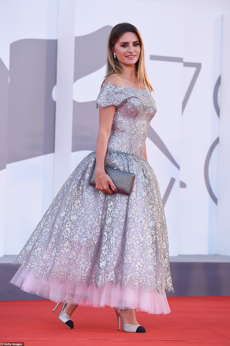 A vision:The Vanilla Sky actress, 47, stunned in a shimmering silver off-the shoulder gown as she posed for the cameras on the final day of the annual event