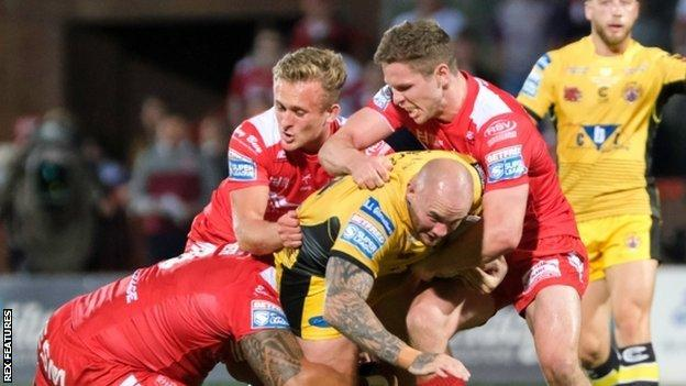 Castleford's Nathan Massey is halted by a Hull KR combination of Albert Vete, Jez Litten and Matt Parcell