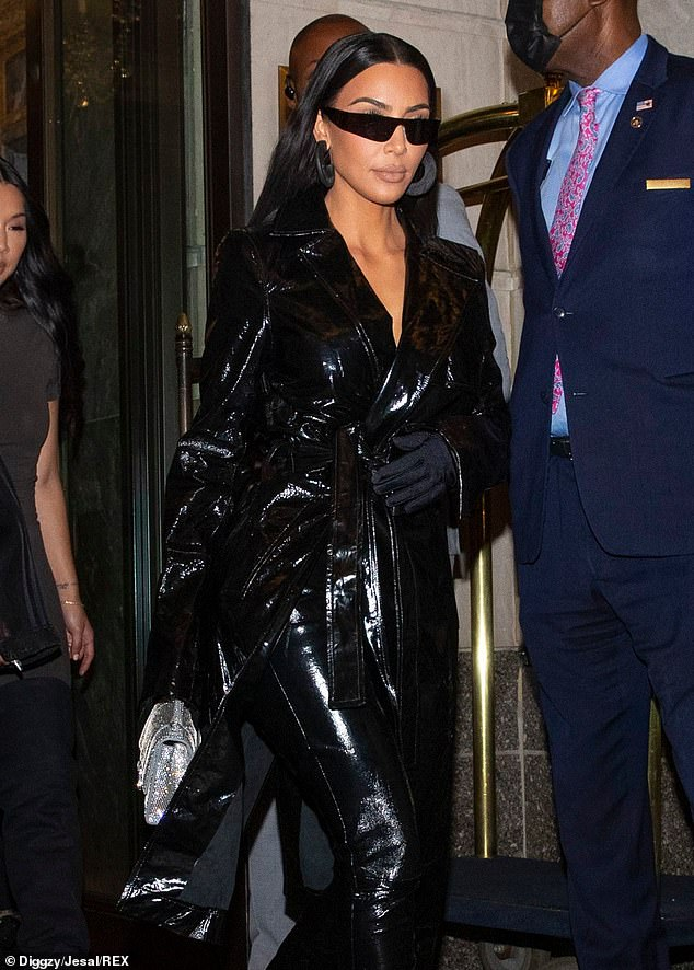 The Matrix:The 40-year-old reality TV star cloaked her curves in a vinyl floor-length coat paired with matching skintight pants