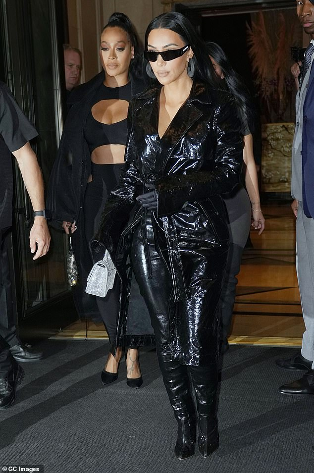 Busty:La La strolled beside Kim in a cleavage-baring cut-out top and a pair of tapered pants that exposed her hips