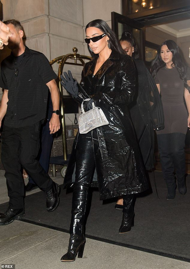 Inches:Kim donned a pair of heeled boots that added inches to her petite 5foot2inch frame
