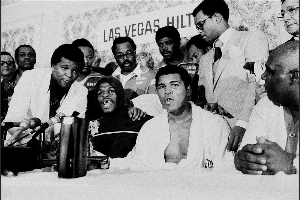 Muhammad Ali (center) and Leon Spinks speak at a news conference on Feb. 15, 1978, in Las Vegas after Spinks beat Ali to win the heavyweight championship from the aging champ. (Courtesy of PBS)