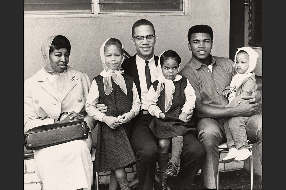 Malcolm X and family pose for a photo with Cassius Clay on a trip to Miami in January 1964. (Courtesy of PBS)