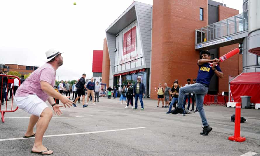 Fans play cricket outside the ground after India forfeited the fifth Test.