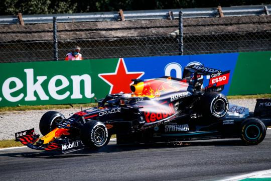Max Verstappen's car went right over Lewis Hamilton's Mercedes