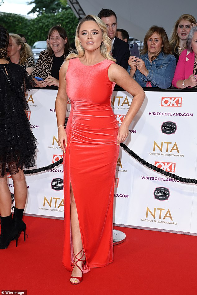 Stunner: Emily looked amazing on the red carpet in a bold red dress just hours prior