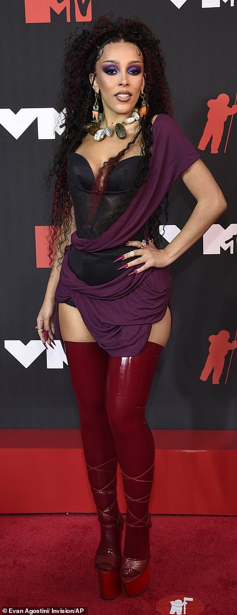 Kick it up:Amping up the sex appeal, she added stacked red platform heels and latex thigh-high stockings for a raunchy touch