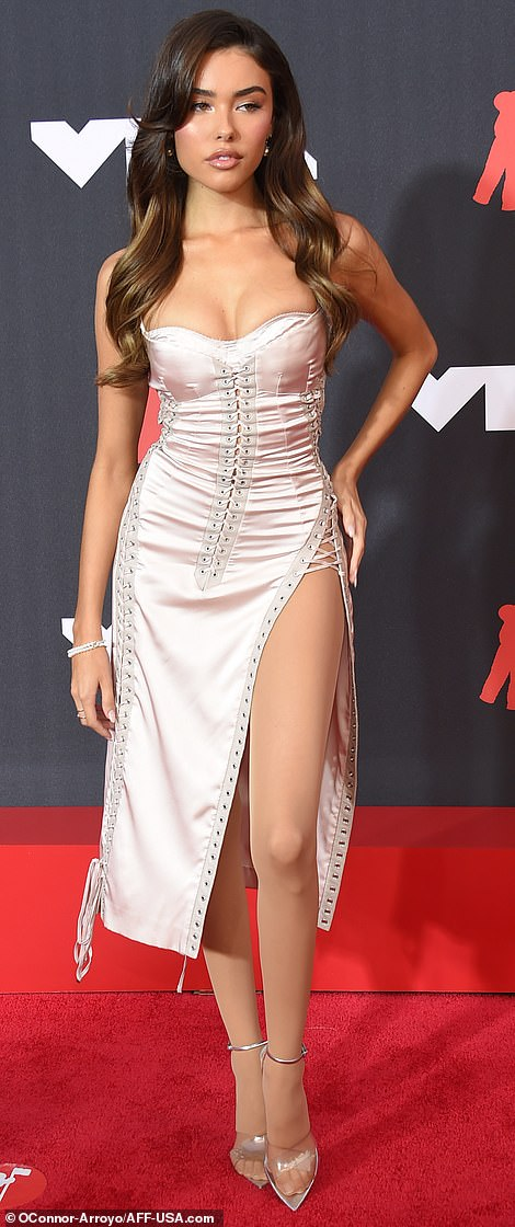 Creme de la creme: Madison Beer looked like a bombshell rocking a slinky off-white slip-dress with lacing down the side