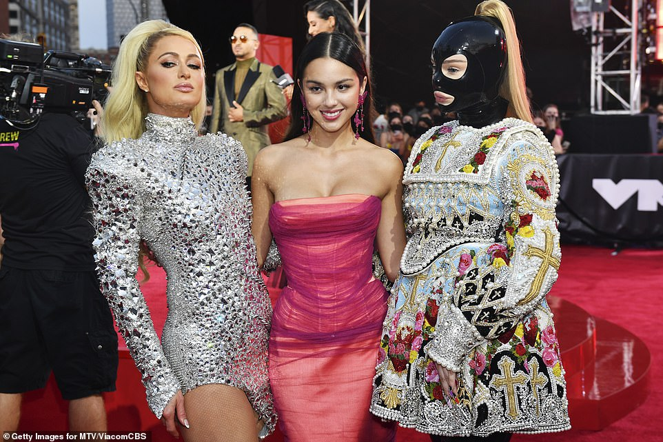 Trio: Paris Hilton and Olivia Rodrigo posed with Kim Petras, who wore a BDSM-inspired mask with a dress that looked plucked from the 17th century