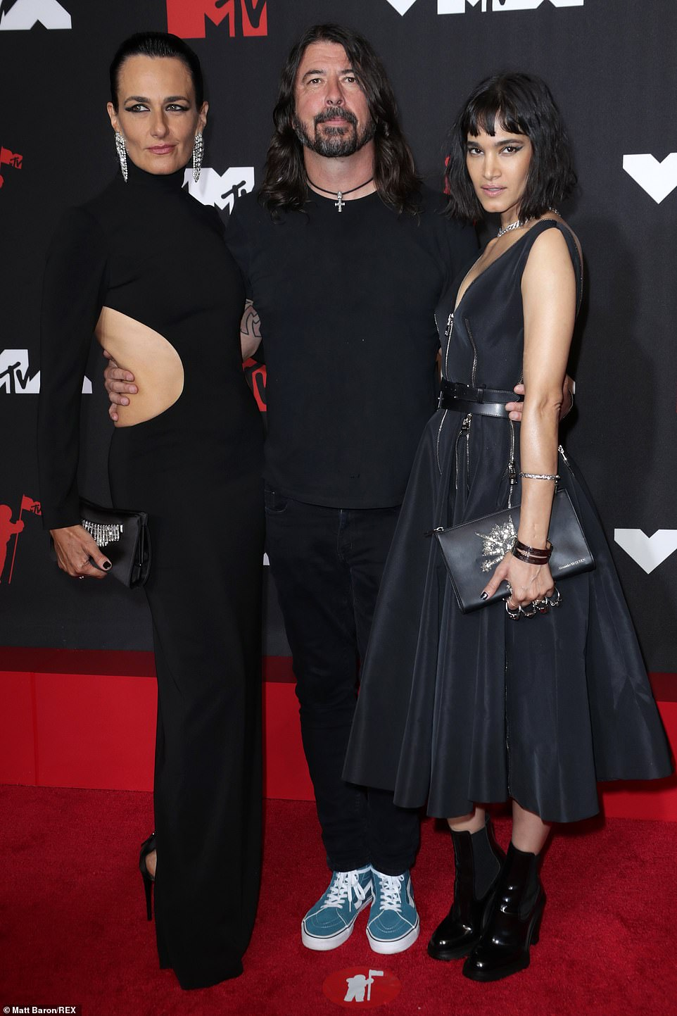 Family affair: Rocker Dave Grohl, who will receive the first-ever VMAs Global Icon award this year, brought a friend and also posed up with actress Sofia Boutella