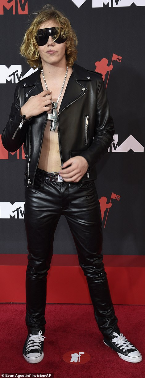 Rock on:The Kid Laroi embraced rocker vibes in leather pants and a motorcycle jacket worn open to reveal his bare chest