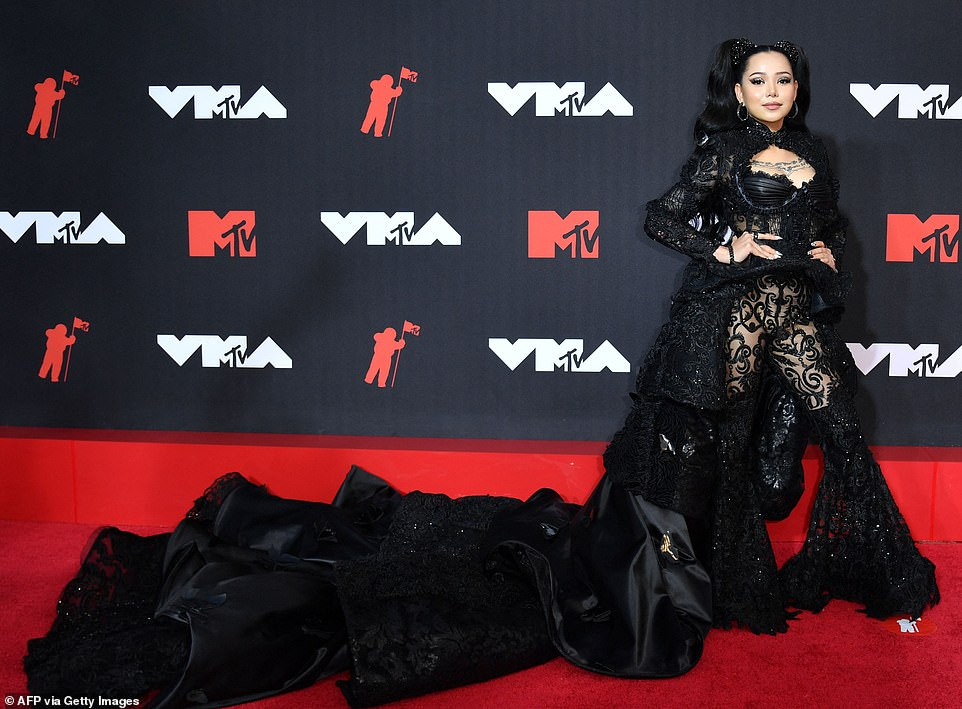 Dark angel:Bella Poarch looked like a vampire queen as she stormed the red carpet wearing an intricately beaded bustier with matching bell bottom trousers and a Victorian-inspired cape with tiers of silk following behind her