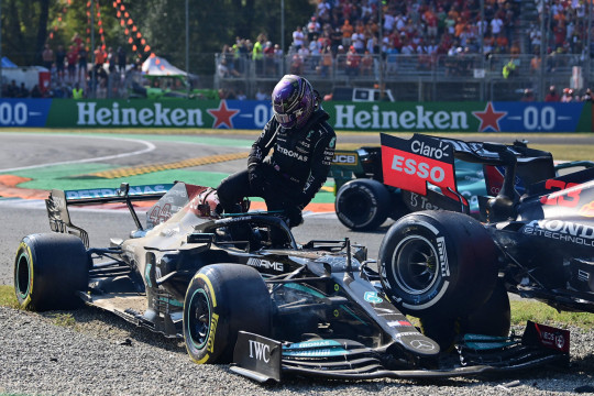 Mercedes' British driver Lewis Hamilton gets out of his car following a collision with Red Bull's Dutch driver Max Verstappen