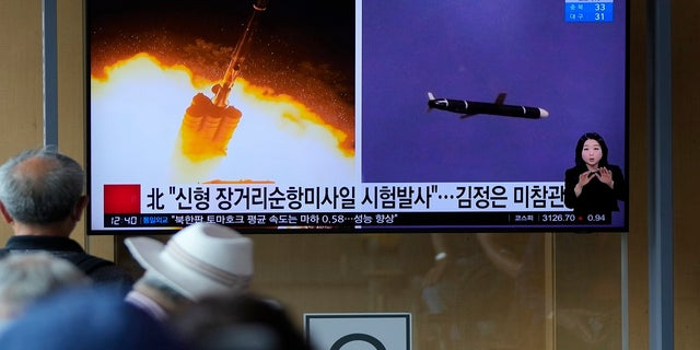 People watch a TV screen showing a news program reporting about North Korea's long-range cruise missiles tests with images in Seoul, South Korea, on Monday.