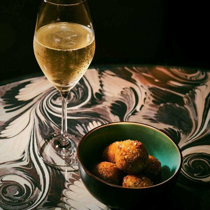Wine with arancini in The Dandy Bar