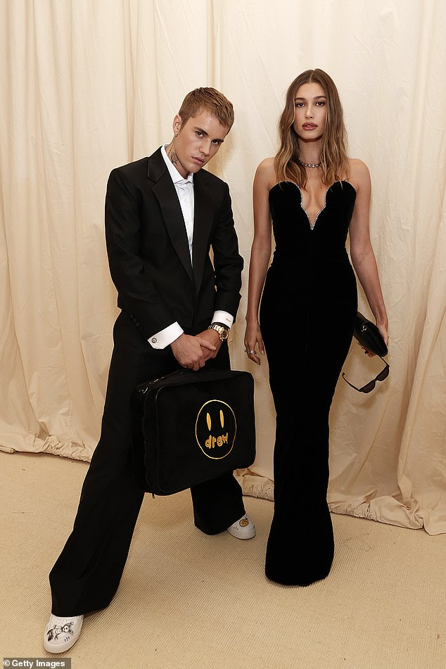 Model behavior: The 27-year-old singer carefully fixed his beloved's face before ushering her up the stairs at the Metropolitan Museum of Art for a night celebrating In America: A Lexicon of Fashion