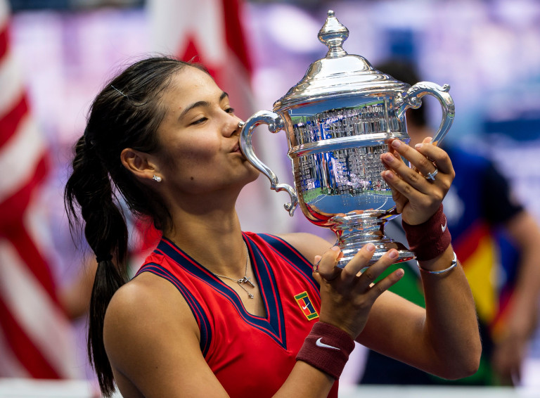 Emma Raducanu of Great Britain celebrates with the US Open winner's trophy