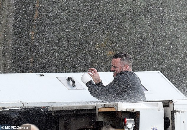 Difficult: Will looked in the zone as he filmed the scenes in the rain
