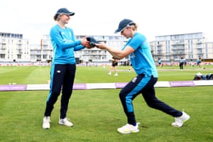 Charlotte Dean receives her cap from England captain Heather Knight.